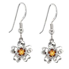 This flower shape earring is so pretty. Two lovely flowers are festooned by Premium Cubic Zirconia and Orange Sapphire in an elegant look. This earring is built from 925 Sterling Silver Rhodium Plated that is loved by every woman. Get it and get ready to impress everyone in special occasions.