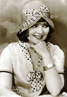 "Clara Bow, 1920s. Clara Gordon Bow (1905 – 1965) was an American actress who rose to stardom in silent film during the 1920s. It was her appearance as a plucky shopgirl in the film It that brought her global fame and the nickname ""The It Girl"". Bow came to personify the Roaring Twenties and is described as its leading sex symbol. (From Wikipedia)"