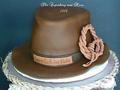 The cake was made to look like the Indiana Jones hat along with his whip. There is something I love about trying to make a cake look like something real. Cowboy Birthday Cakes, Birthday Cakes For Men, Birthday Desserts, 80th Birthday, Mini Cupcakes, Cupcake Cakes, Cupcake Toppers, Indiana Jones Cake, Indiana Jones Birthday Party