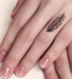 indian feather delicate tattoo on finger- It describes the wearer to be a free bird in flight, and the tattoo can also be part of angelic symbolization.