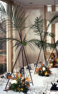 Tropical arrangement using black Bamboo and Orchids