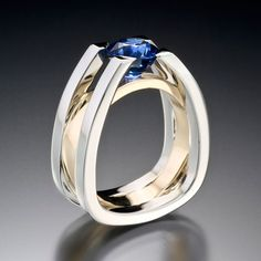 Adam Neeley Fine Art Jewelry - Forte - Strength and structure. This architecturally inspired Men's ring suspends a carat royal blue sapphire in white gold and yellow gold. Modern Jewelry, Jewelry Art, Jewelry Rings, Silver Jewelry, Vintage Jewelry, Jewelry Accessories, Fine Jewelry, Jewelry Quotes, Jewellery Earrings