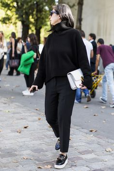 Black turtleneck sweater, white bag.
