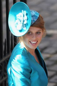 now this is a wonderful hat Beatrice choose she wore it to her cousin Zara Phillips wedding and if i may add Beatrice is very lovely in blue but isn't all royals though