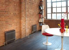 Bisque use brickwork in room sets showing a bare metal Classic radiator.