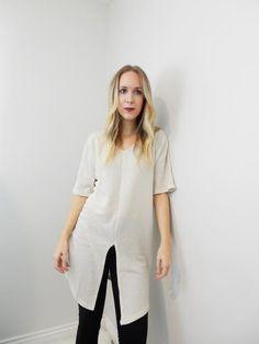 Waffle-knit, long cream short sleeve shirt with front slit.