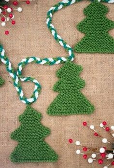 Knit some mini trees to go around your big tree for the ultimate Christmas display! Gina Michele's pattern is a great one for knitting beginners.