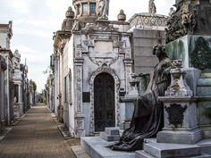 Organized like a city with neat rows, blocks of marble and brass form mausoleum-lined streets.