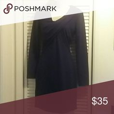 Walter Baker Dress The perfect little black dress is a polyester spandex blend. Beautifully tailored with a draped neckline. This dress flatters the figure perfectly. W118 by Walter Baker Dresses Long Sleeve