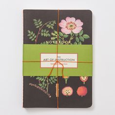 """Jot down observations from the garden in these slim notebooks, covered with botanical illustrations from vintage instructional charts.- Set of three- Lined paper, sage ink, foil, twine- 64 pages each- Imported8.5""""H, 6""""W"""
