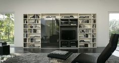 Logo 200 Wall Unit with Bookcase System by Sangiacomo, Italy has Bookcase in mat lacquered Cipria, sliding door in lacquered Artico glass. Manufactured By San Giacomo.
