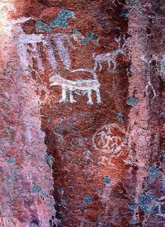 Rock art at MAVADAIPPU, IN the backdrop of the Anamalai hills, human and animal figures in white ochre.