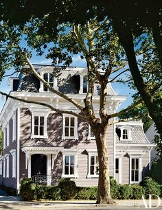In Sag Harbor, New York, designer Michael Lee and friends Alex and Sue Glasscock converted an 1865 Second Empire–style town house from a triplex back to a single-family residence | archdigest.com