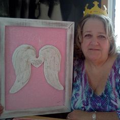 I got this idea of paper mache angel wings and took it one step further. Now you take it a step further and see what you can do with. My background is a canvas board layered with paper mache tissue wrap to  give it a unique texture. Husband Dan made the pic frame. Hes so handy. Love you!