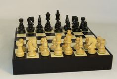 """The Game Supply - Black Russian With Black Storage Chest Board, $119.95. Great value! Chess set and chessmen storage! Black/Natural Boxwood Russian Knight weighted and felted chessmen: 13.25"""" x 13.25"""" x 2.5"""" Black/Maple Inlaid veneer storage chest board with 1.5"""" squares, 3.5"""" king with 1.4"""" king base width. (http://www.thegamesupply.com/black-russian-with-black-storage-chest-board/) #woodchesssets #russianchesssets"""