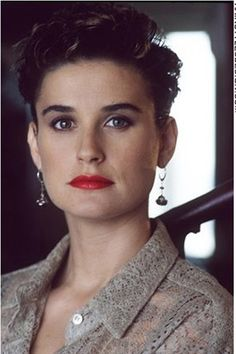Demi Moore has her hair styled very short. On the top, Demi's hair is thick and layered. At the sides, the hair is styled behind the ears leaving this a cute retro style.Demi's haircut is short and layered. The back is cut close to the head along with behind the ears.