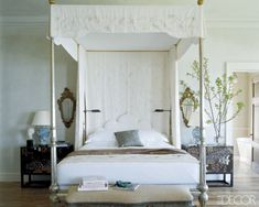 Michael S. Smith takes inspiration from Bunny Williams with this German-silver four-poster by John Robshaw Textiles is topped with a canopy embroidered by Ankasa; the lacquer bedside chests are Japanese, and the reading lamps are by Visual Comfort & Co.