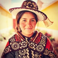 Our eyes wonder between this young Andean woman's radiant smile and natural beauty to the unique embroidery and patterns that surrounds her traditional dress. She belongs to a small community on the shores of Piuray Lagoon in Chinchero, Peru. Today and every day it's the beauty of the people of Latin America that inspires us. Love this portrait by documentary photographer @tucciphoto #Inspiration #Peru #Cusco #CulturalMixology
