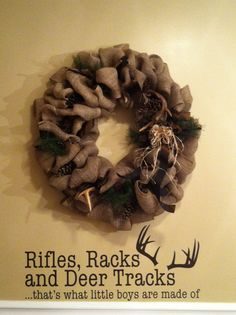 """4 inch Burlap, antlers, pine cones, brown ribbon, pine needles, and a raffia bow...  Perfect for my boys' new """"Hunting Lodge"""" bathroom.  Can be made by Sarah Storie at Salon S.  Bow, raffia, and pine needles added by my mom, Becky Matheny (lol) ...LOVE IT!!!!  Wall decals purchased at primitivecraftcom"""