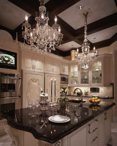 This kitchen is too beautiful to cook in.  I can't imagine to horror of spilling tomato sauce in there.