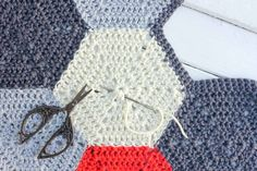 How to weave in crochet ends on hexagons or other pieces using a magic circle technique.