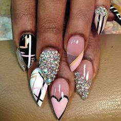 Pink bling out stiletto nails