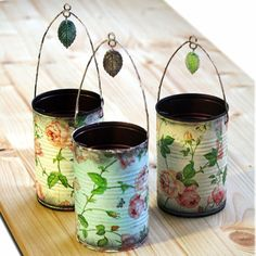 old tin can, decoupage wallpaper or tissue paper, a wire hanger & a small charm..cute as can be flower vase or whatever you want