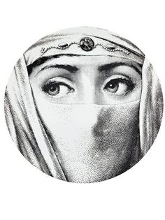 Printed black and white porcelain plate from Fornasetti featuring a woman's veiled face.