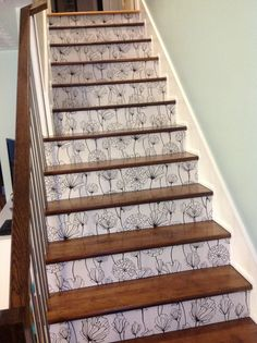 wallpapered stair risers ~ think I might paper the garage stairs & paint the treads black