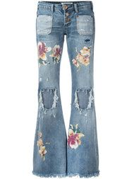 Shop One Teaspoon distressed orchid print flared jeans.