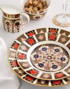 Old Imari china from Royal Crown Derby features an intricately layered geometric print mixed with striking floral motifs.