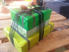 Birthday present gift tower. Green wrapping paper, washi tape, black ribbon, bakery twine.