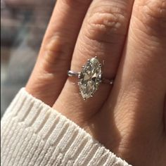 This vintage marquise diamond engagement ring centers a gorgeous GIA certified diamond weighing 2.58 carats, with a thin, understated platinum band. Shop today!