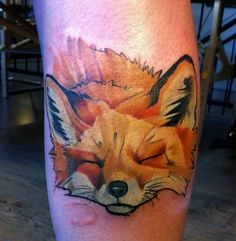 Hungarian tattoo artist Csiga creates a peaceful and artistic animal portrait of a fox in this nature tattoo