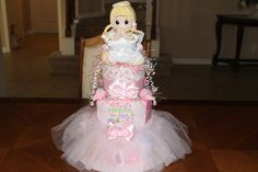 Thank Heaven for Little Girls!! Pink, frilly fondant style 3 tier diaper cake.
