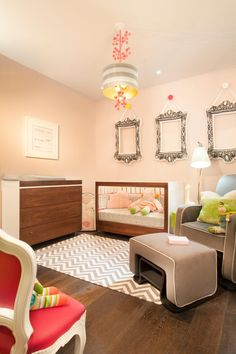 The organic textures of a modern wood changing table and crib contrast brilliantly with bright accent colors, exciting patterns of chevron and stripes and a comfortable rocking chair with a gliding ottoman to create a fun, vibrant and peaceful nursery