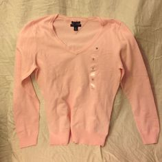 Tommy Hilfiger baby pink Light Sweater Tommy Hilfiger baby pink Light Sweater. This sweater has never Been Worn and still has Tag on it. It is a baby pink with a v-neck. Tommy Hilfiger Sweaters V-Necks