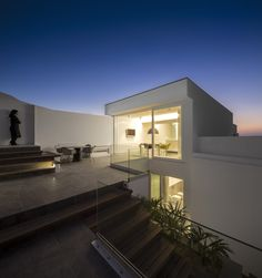 This house by Architect Marlene Uldschmidt has been built into the side of a hill in Portugal
