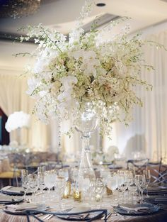 Orchid & Rose Arrangement in Tall Glass Vase | Photography: Abby Jiu Photography. Read More:  http://www.insideweddings.com/weddings/ballroom-wedding-with-classic-color-scheme-modern-catering-trends/827/
