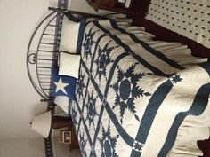 Blue and white Feathered Star quilt by Mary Ann Fielder.