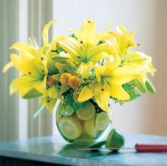 Order LILIES AND LEMONS from Longmont Florist, Inc., your local Longmont florist. For fresh and fast flower delivery throughout Longmont, CO area. Yellow Flower Arrangements, Flower Vases, Yellow Flowers, Flower Table, Fruit Arrangements, In Bloom Florist, Fast Flowers, Same Day Flower Delivery, Amazing Flowers