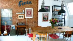 Exposed brick & white walls, comfy decor with cheerful, colorful accents