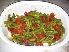 1  1/2 lb green beans, trimmed and cut into 2 inch pieces. 1  1/2 cup water 1/4 cup butter 1 tbsp  sugar 3/4 tsp garlic salt 1/4 tsp black pepper 1  1/2 tsp fresh basil, chopped 2 cups cherry tomato, halved  Directions: 1.  Place beans and water in large saucepan. Cover, and bring to boil. Set heat to low, and simmer until tender, about 10 minutes. Drain off water, and set aside. 2. Melt butter in a skillet  over medium heat. Stir in sugar, garlic salt, pepper, and basil. Add tomatoes, and cook stirring gently just until soft. Pour the tomato mixture over the green beans, and toss gently to blend.   ***Enjoy***