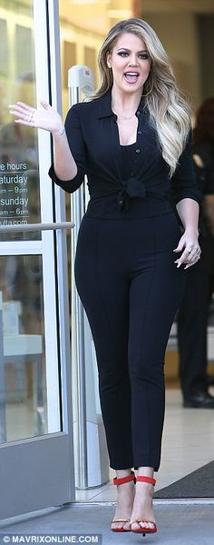 Glamourpuss: The brunette beauty showcased her curves in figure-hugging black trousers, a ...
