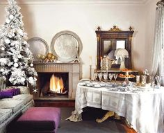 christmas buffet table. I like the silver and white linen.