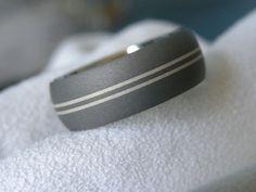Titanium Ring Double Silver Pinstripe Inlay Band Sandblasted Finish. $55.00, via Etsy.