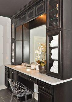 single sink, floor-to-ceiling storage, and vanity