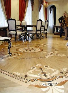 An amazing floor design.....they even laid the wood all pointing into the center medallion.  I'd be afraid to walk on this floor for fear of scratching the finish!