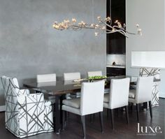 Neutral Modern Dining Room With Tree Branch Chandelier