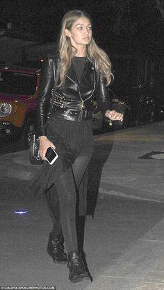 All black everything: The gorgeous 20-year-old covered her willowy frame in skintight leggings, a long flowing top and a classic leather jacket for the late-night soiree